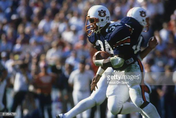 Running back Bo Jackson of the Auburn Tigers runs with the ball during a game in the 1980's
