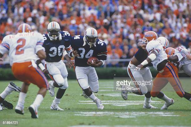 Running back Bo Jackson of the Auburn University Tigers moves the ball with his teammates against the Florida Gators during the 1980's