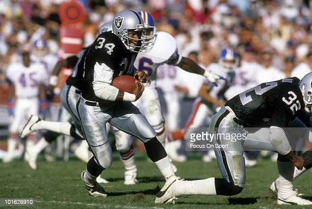 Running back Bo Jackson of the Los Angeles Raiders in action carries the ball against the Denver Broncos December 3 1989 during an NFL game at the...