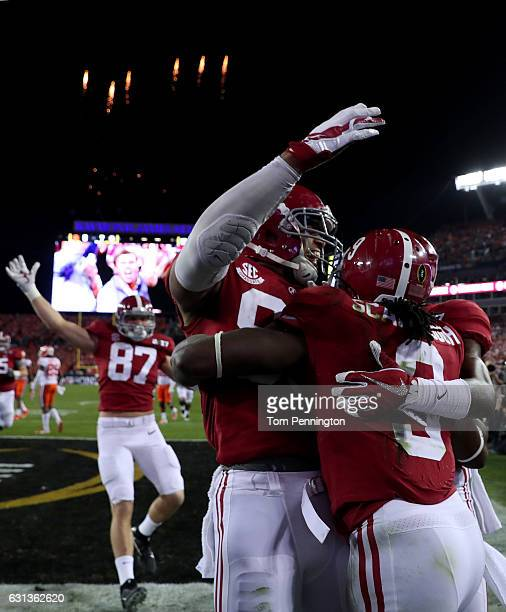 Running back Bo Scarbrough of the Alabama Crimson Tide celebrates with teammates after rushing for a 37-yard touchdown during the second quarter...