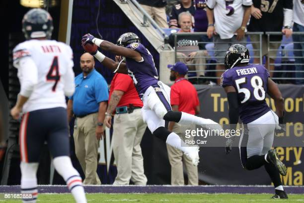 Running Back Bobby Rainey of the Baltimore Ravens scores a touchdown on a kick return in the third quarter against the Chicago Bears at MT Bank...