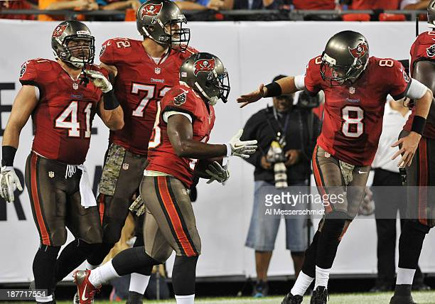 Running back Bobby Rainey of the Tampa Bay Buccaneers celebrates after a touchdown run with quarterback Mike Glennon against the Miami Dolphins...