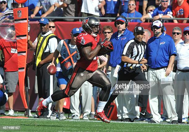Running back Bobby Rainey of the Tampa Bay Buccaneers runs 80 yards for a touchdown on the second play of the game against the Buffalo Bills December...