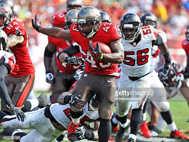 Running back Bobby Rainey of the Tampa Bay Buccaneers runs for a gain in the 2nd quarter against the Atlanta Falcons November 17 2013 at Raymond...