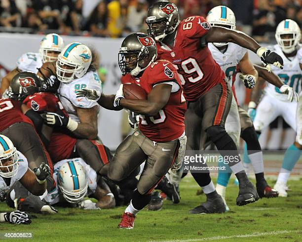 Running back Bobby Rainey of the Tampa Bay Buccaneers runs for a gain against the Miami Dolphins November 11 2013 at Raymond James Stadium in Tampa...