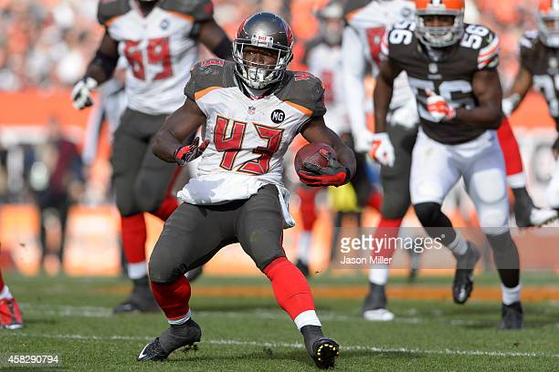 Running back Bobby Rainey of the Tampa Bay Buccaneers runs for a gain during the first half against the Cleveland Browns at FirstEnergy Stadium on...