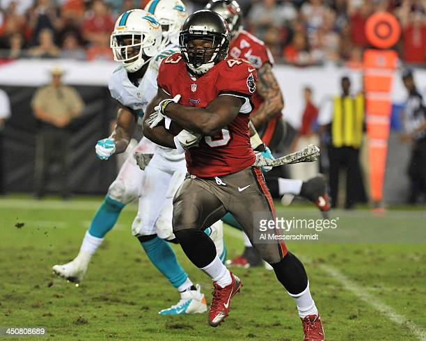 Running back Bobby Rainey of the Tampa Bay Buccaneers runs for a touchdown against the Miami Dolphins November 11 2013 at Raymond James Stadium in...