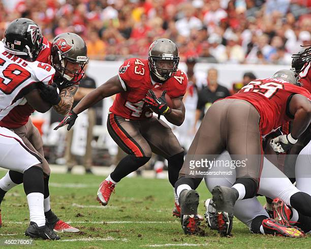 Running back Bobby Rainey of the Tampa Bay Buccaneers rushes upfield against the Atlanta Falcons November 17 2013 at Raymond James Stadium in Tampa...