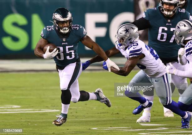 Running back Boston Scott of the Philadelphia Eagles runs with the ball against Xavier Woods of the Dallas Cowboys in the first quarter of the game...