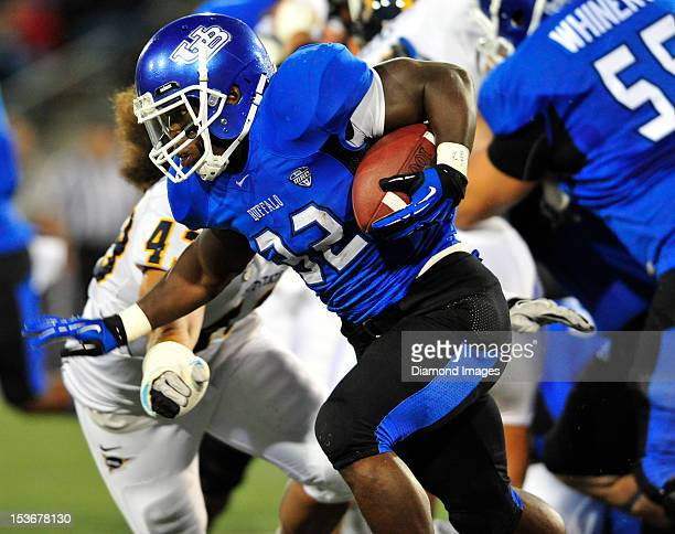 Running back Branden Oliver of the Buffalo Bulls runs the ball during a game with the Kent State Golden Flashes at UB Stadium in Buffalo New York The...