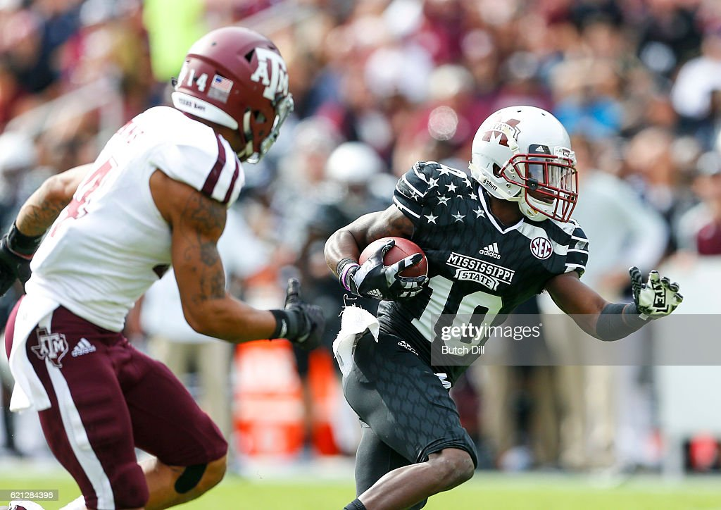 Running back Brandon Holloway #10 of the Mississippi State Bulldogs carries the ball for a first down during the second half of an NCAA college football game against the Texas A&M Aggies at Davis Wade Stadium on November 5, 2016 in Starkville, Mississippi.