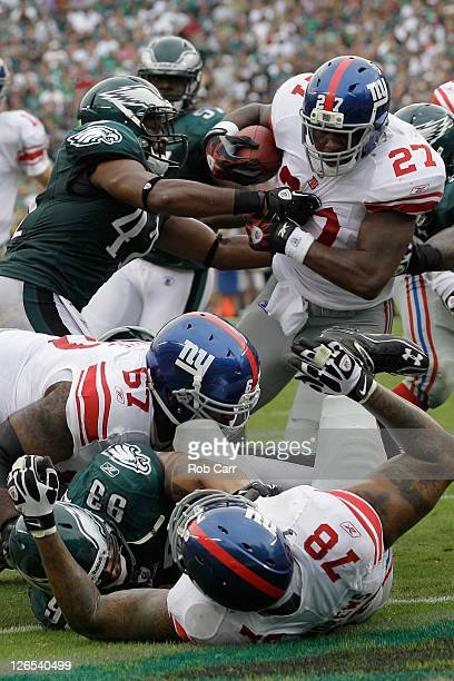 Running back Brandon Jacobs of the New York Giants breaks the tackle of defender Jarrad Page of the Philadelphia Eagles for a two point conversion...