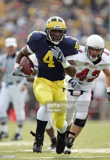 Running back Brandon Minor of the Michigan Wolverines breaks free en route to a touchdown against the Ball State Cardinals in the second quarter on...