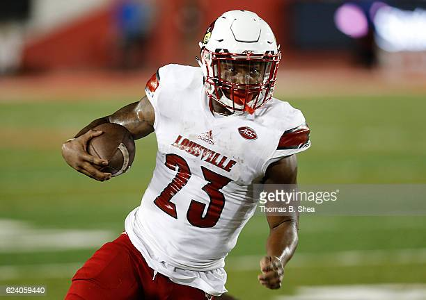 Running back Brandon Radcliff of the Louisville Cardinals rushes against the Houston Cougars in the third quarter at TDECU Stadium on November 17...