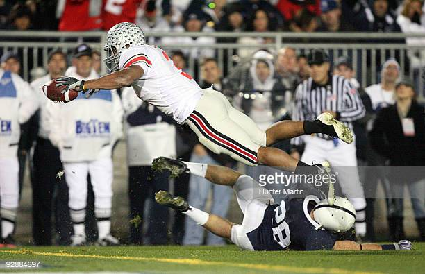 Running back Brandon Saine of the Ohio State Buckeyes dives for the end zone and scores a 6 yard touchdown during a game against the Penn State...