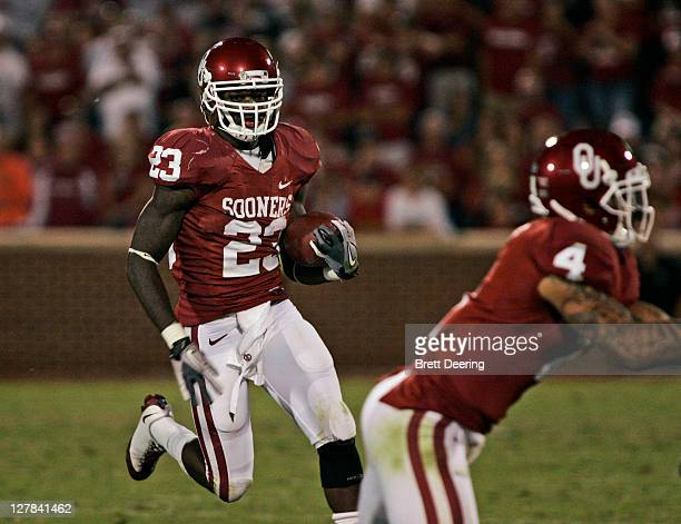 Running back Brandon Williams of the Oklahoma Sooners rushes up field in the second half against the Ball State Cardinals on October 1 2011 at...