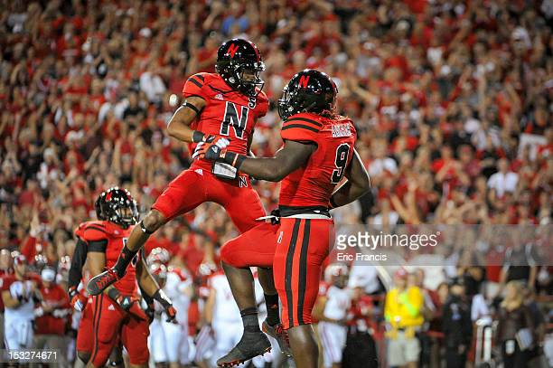 Running back Braylon Heard celebrates with defensive end Jason Ankrah of the Nebraska Cornhuskers during their game against the Wisconsin Badgers at...