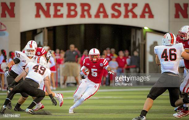 Running back Braylon Heard of the Nebraska Cornhuskers slices through the Idaho State Bengal defense during their game at Memorial Stadium on...