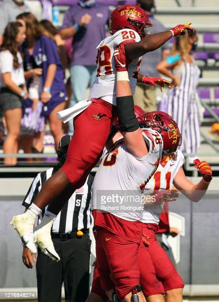 Running back Breece Hall of the Iowa State Cyclones gets lifted by offensive lineman Nick Lawler of the Iowa State Cyclones after a fourth quarter...