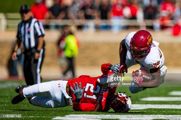 Running back Breece Hall of the Iowa State Cyclones is tackled by linebacker Evan Rambo of the Texas Tech Red Raiders during the first half of the...
