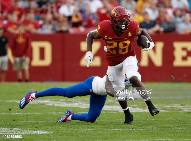 Running back Breece Hall of the Iowa State Cyclones rushes for yards past cornerback Ra'Mello Dotson of the Kansas Jayhawks in the first half of play...
