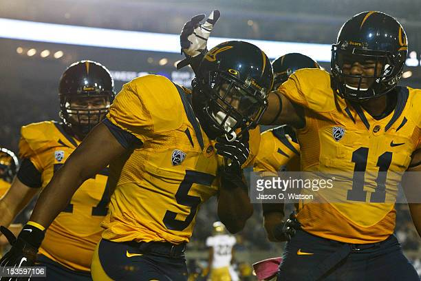Running back Brendan Bigelow of the California Golden Bears is congratulated by tight end Richard Rodgers after scoring a touchdown against the UCLA...