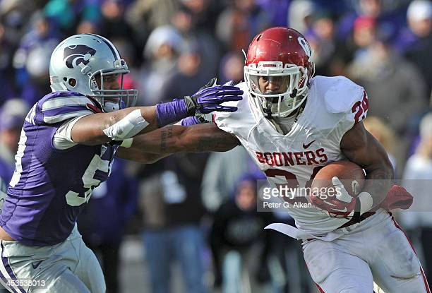 Running back Brennan Clay of the Oklahoma Sooners rushes against linebacker Blake Slaughter of the Kansas State Wildcats during the second half on...