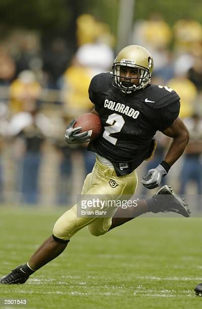 Running back Brian Calhoun of the Colorado Buffaloes cuts inside against the UCLA Bruins on September 6 2003 at Folsom Field in Boulder Colorado...