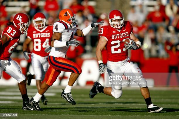 Running Back Brian Leonard of the Rutgers Scarlet Knights runs with the ball while being chased by Terrell Lemon of the Syracuse Orange at Rutgers...