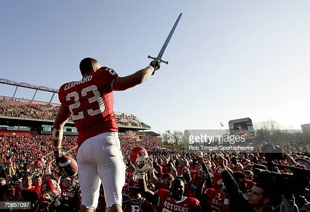 Running Back Brian Leonard of the Rutgers Scarlet Knights waves farewell to the crowd and his team after defeating the Syracuse Orange during his...