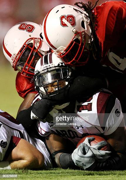 Running back Brian Maddox of the South Carolina Gamecocks is tackled during the game against the North Carolina State Wolfpack at CarterFinley...
