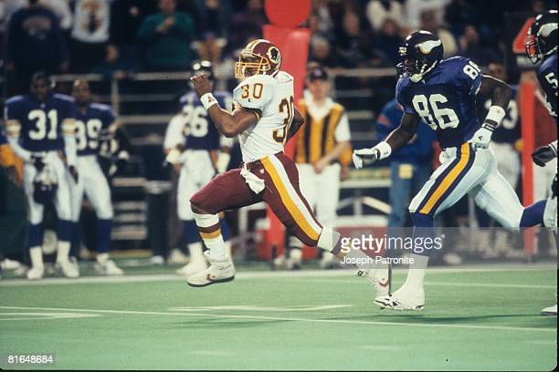 Running back Brian Mitchell of the Washington Redskins runs upfield on a 36yard fake punt against the Minnesota Vikings in the 1992 NFC Wildcard Game...
