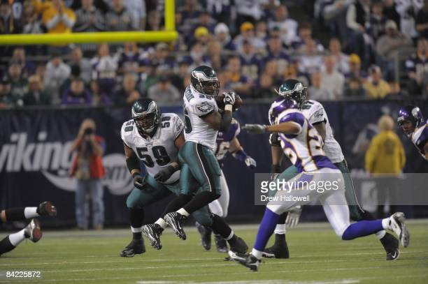 Running back Brian Westbrook of the Philadelphia Eagles catches a screen pass which he then runs for a touchdown during the game against the...