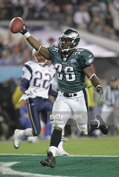 Running back Brian Westbrook of the Philadelphia Eagles celebrates after catching a 10yard touchdown pass against the New England Patriots during the...