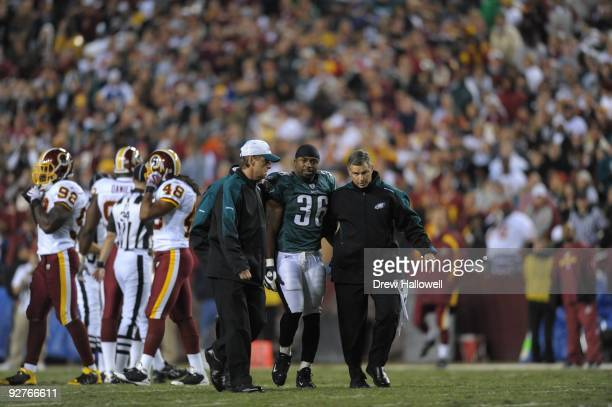 Running back Brian Westbrook of the Philadelphia Eagles is assisted off the field after getting injured during the game against the Washington...