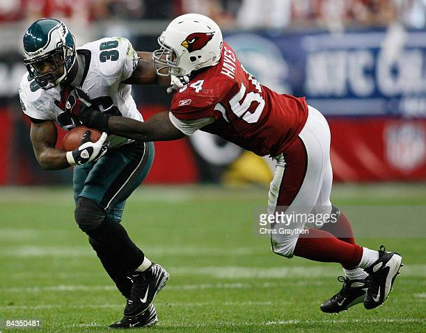 Running back Brian Westbrook of the Philadelphia Eagles is tackled by linebacker Gerald Hayes of the Arizona Cardinals during the NFC championship...