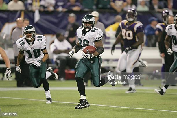 Running back Brian Westbrook of the Philadelphia Eagles runs for a 71 yard touchdown off a screen pass during the NFC Wild Card playoff game against...