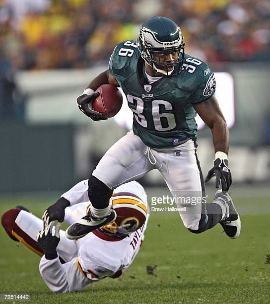 Running back Brian Westbrook of the Philadelphia Eagles runs past safety Sean Taylor of the Washington Redskins on November 12 2006 at Lincoln...