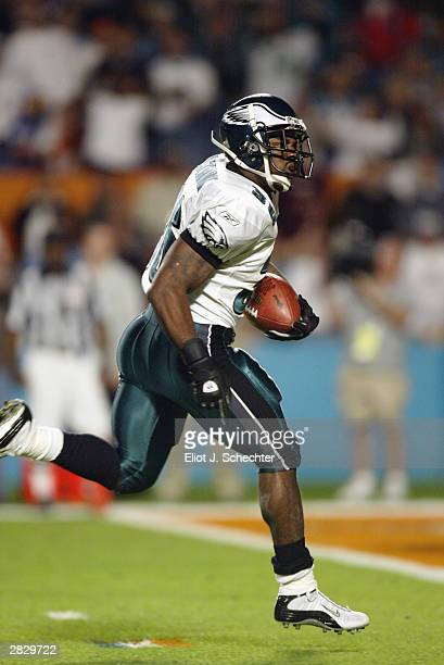 Running back Brian Westbrook of the Philadelphia Eagles runs up the middle and into the endzone for a 21yard touchdown against the Miami Dolphins to...