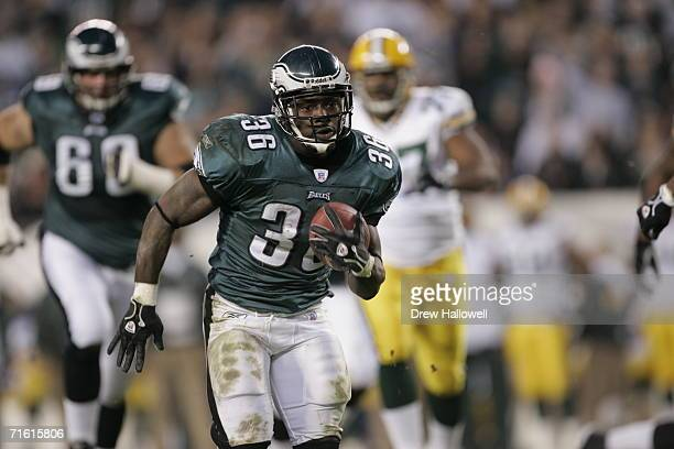 Running back Brian Westbrook of the Philadelphia Eagles runs with the ball during the game against the Green Bay Packers on November 27 2005 at...