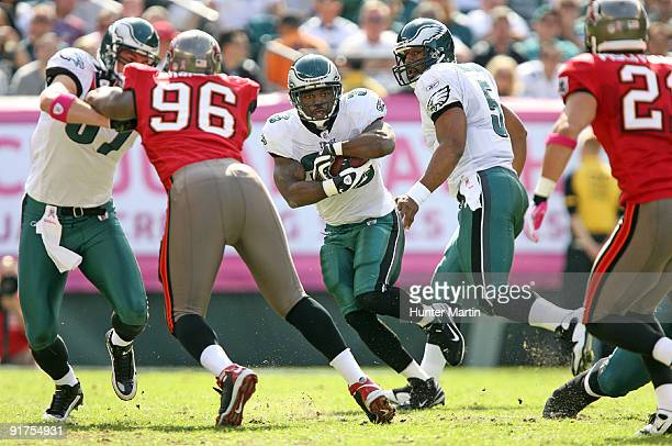 Running back Brian Westbrook of the Philadelphia Eagles takes a hand off from quarterback Donovan McNabb during a game against the Tampa Bay...