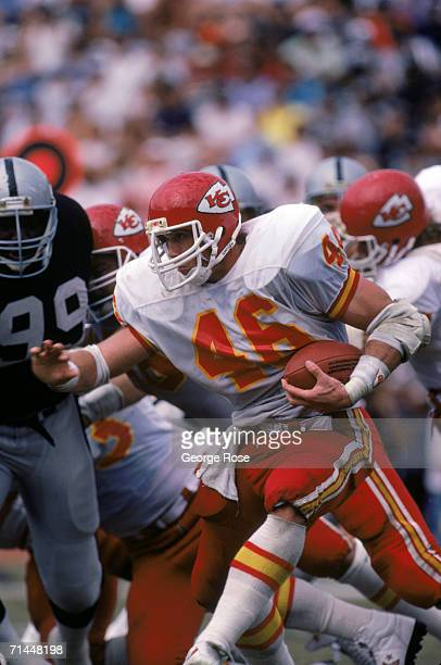 Running back Bruce King of the Kansas City Chiefs battles for yards during a game against the Los Angeles Raiders at Los Angeles Memorial Coliseum on...