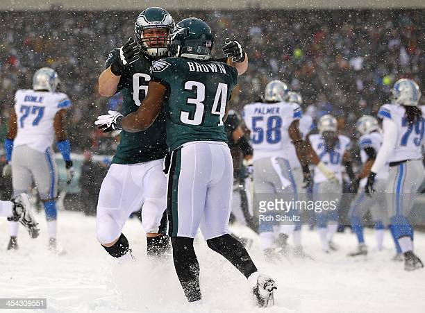 Running back Bryce Brown of the Philadelphia Eagles is congratulated by teammate offensive tackle Lane Johnson after scoring a two point conversion...