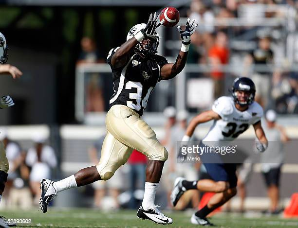 Running back Brynn Harvey of the Central Florida Knights catches a screen pass against the Florida International Panthers during the game at Bright...