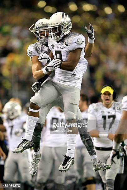 Running back Byron Marshall of the Oregon Ducks celebrates after scoring a 70 yard touchdown in the third quarter against the Ohio State Buckeyes...