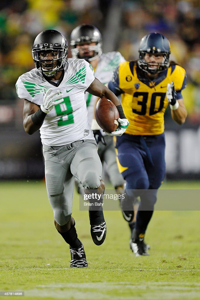 Running back Byron Marshall #9 of the Oregon Ducks picks a first down and then some against linebacker Jake Kearney #30 of the California Golden Bears in the second quarter on October 24, 2014 at Levi's Stadium in Santa Clara, California.