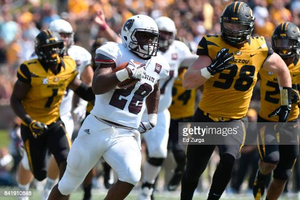 Running back Calan Crowder of the Missouri State Bears runs for a touchdown against Anthony Hines and Eric Beisel of the Missouri Tigers in the first...