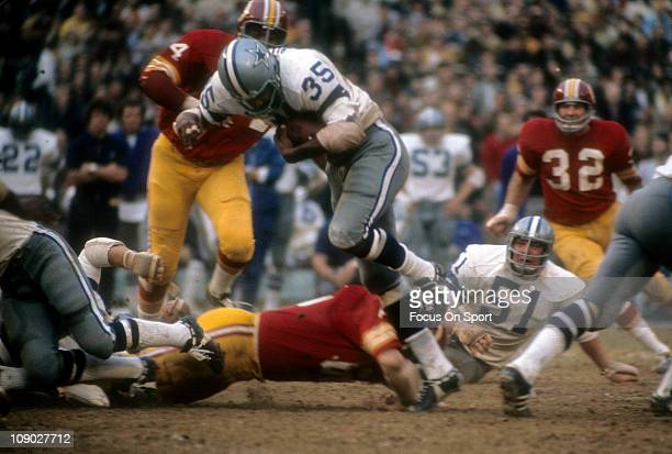 Running back Calvin Hill of the Dallas Cowboys carries the ball against the Washington Redskins during an NFL game at RFK Stadium October 8 1973 in...