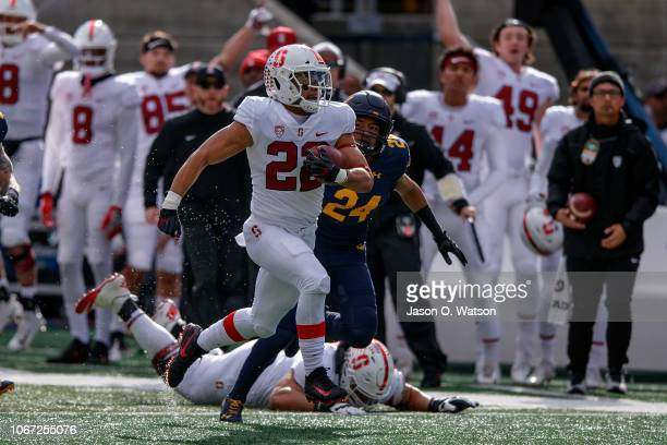 Running back Cameron Scarlett of the Stanford Cardinal rushes up field for a touchdown against the California Golden Bears during the first quarter...