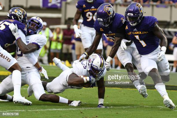 Running back Cardon Johnson of the James Madison Dukes dives for more yards during a game between the James Madison Dukes and the East Carolina...